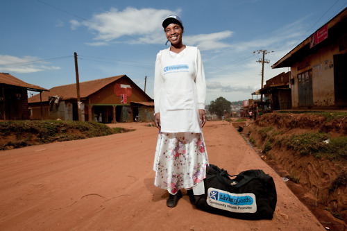 Joy Twinomusasizi, proudly stands in her neighborhood with her bag full of life-saving medical supplies. Walking door-to-door, Joy sells essential health supplies in her community.  Learn more at The Adventure Project.  Photo by Esther Havens.