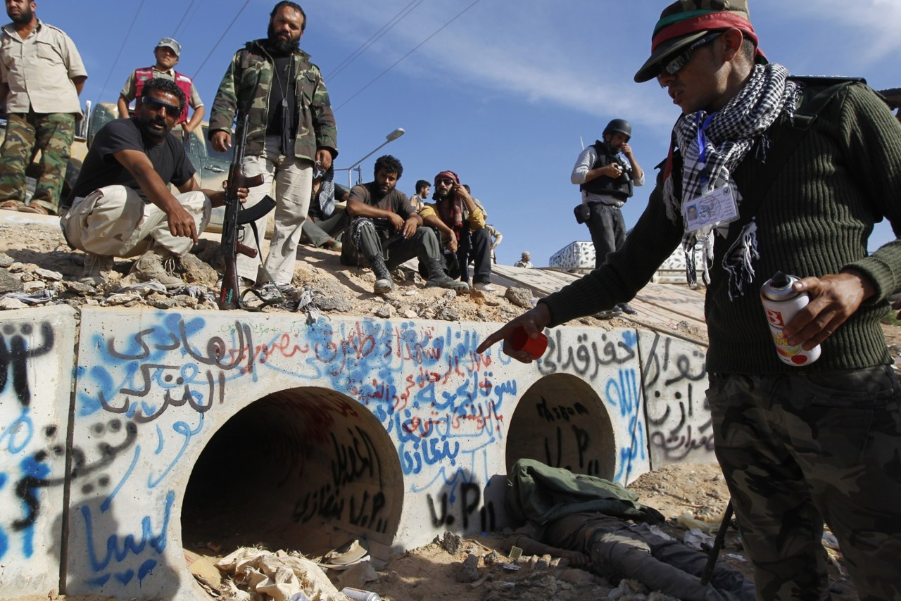 Muammar Gaddafi dead: Former Libyan dictator found hiding in a sewer waving a golden gunFormer Libyan dictator Muammar Gaddafi was found hiding in a drainage culvert waving a golden gun as he tried to flee National Transitional Council fighters who had overran his hometown and final bastion on Thursday.According to various sources, the former Libyan dictator may have tried to break out of his final redoubt at dawn in a convoy of vehicles after weeks of dogged resistance.However, he was stopped by a NATO airstrike and captured, possibly three or four hours later, after gunbattles with NTC fighters who found him hiding in a drainage culvert.Moments later, his bloodied body was stripped and displayed around the world from cellphone video. (Photo: Thaier al-Sudani/Reuters)