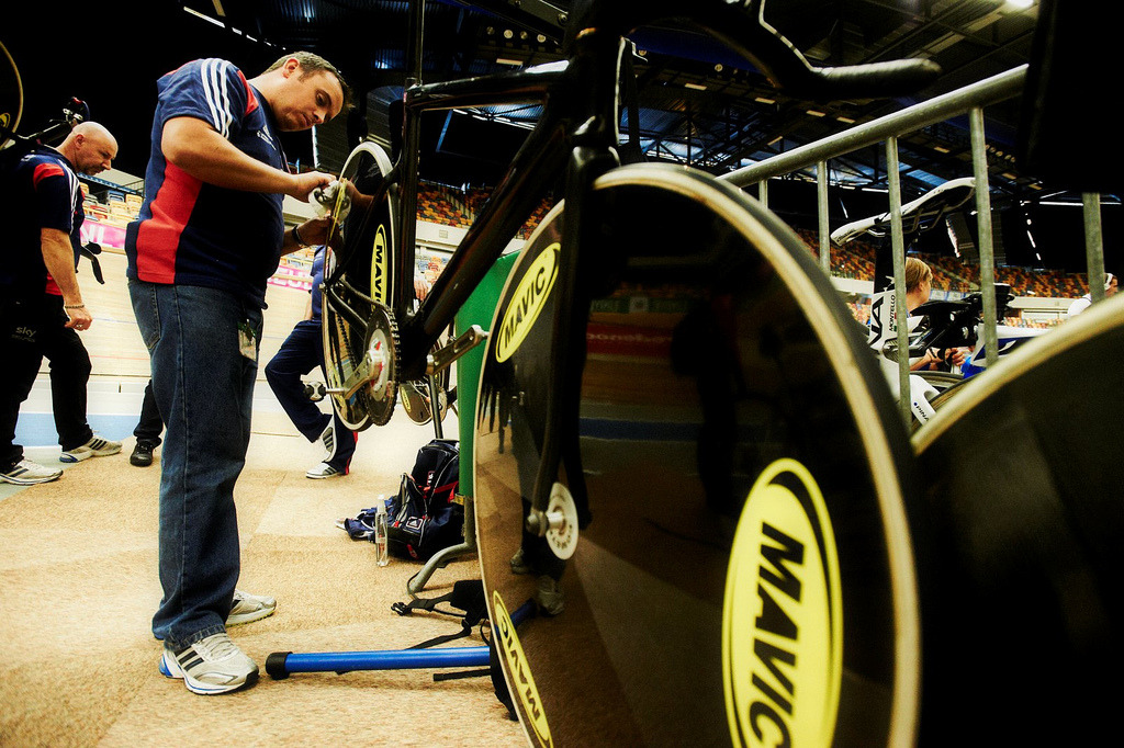 EURO CHAMPS: PREPARATION   As the velodrome events at Pan Am Games wrapping up, trackies across the pond are preparing for the European Championships in Apeldoorn.  This is the first major international event in Europe and the start of the last season before the Summer Olympics.  The racing will be fierce as riders fight for those Olympic qualification points to make it to London 2012.  European Champs start tomorrow at the Omnisport Velodrome.  Check out a write-up from the British perspective and some more photos at British Cycling.  PRO TIP:  The mechanic pictured above is cleaning the tires with vinegar.