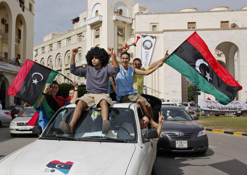 nationaljournal:  PHOTO OF THE DAY: Libyans celebrate Muammar el-Qaddafi death in Tripoli, Libya, on Thursday. Libya's information minister said Qaddafi was killed on Thursday when revolutionary forces overwhelmed his hometown, Surt, the last major bastion of resistance two months after the regime fell. (PHOTO: Abdel Magid al-Fergany/AP)
