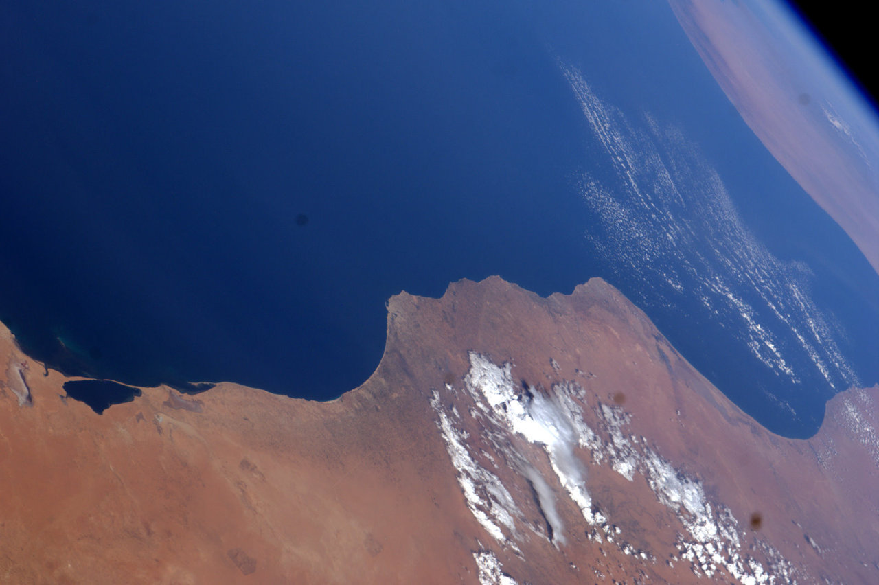 The Libyan coast looks peaceful from orbit, as seen from aboard the International Space Station in late summer (photo by NASA Astronaut Ron Garan, Expedition 27/28).