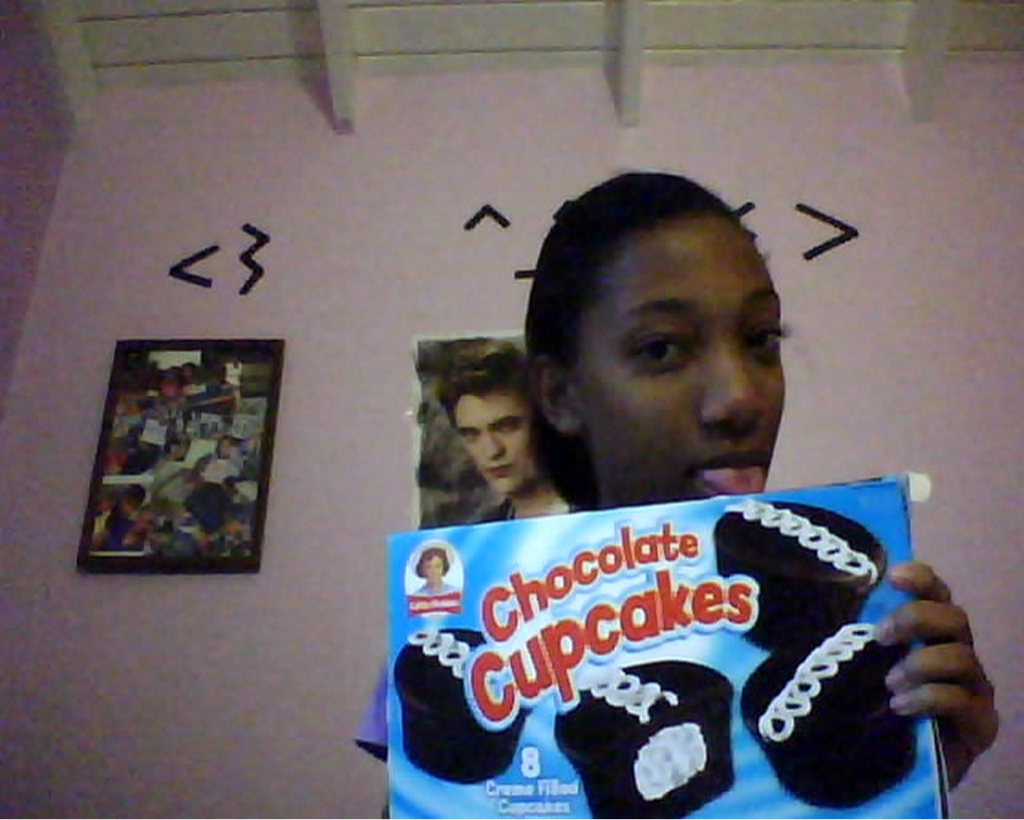 so im like obsessedd with Hostess chocolate cupcakes,. I tasted my first one in st.kitts and i fell in love with them since. Ahh i been craving for them for two months noww and i left st.kitts like 7 years. Im back in jamaica, Anyway, my best friend went up to america and i asked her to buy me them, she couldnt get the uh hostess but she got lil debbies and im just freaking out . Im about to take a bite o,o! Eeek!