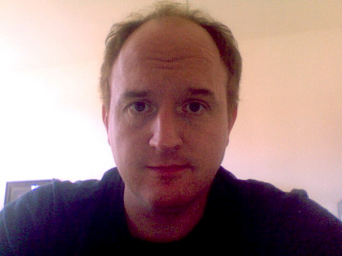"huffpostcomedy:  Louis C.K. without a beard.  From his website: I just finished two days of filming on ""This Side of the Truth"" a new film written and being directed by Ricky Gervais and Matthew Robinson and starring Ricky Gervais. I play Ricky's best friend, a very smelly and sad man named Greg. I am giantly intimidated by Ricky because he is great and hilarious and more than that, he's precise, and focused and creative and thoughtful. I went into this project truly afraid that I might be ruining great art. But Ricky's energy is very infectious and he just inspires you to do your best. So I am having a great time and it may just be possible that I don't suck in this movie too badly. Ricky and Matt asked me to shave my beard for the part which was kind of a shock to my system. I have had a goatee beard since I was in my early twenties, so pretty much my whole adult life. So shaving it off and seeing fourty percent of my face for the first time in about twenty years was kind of… awful. ""So that's what's been going on under there"". Ugh. My chin, and the one behind it, looked like a porn actor's shaved balls.  [via: zachdionne:bowlingalley-lawyer] What even is this."