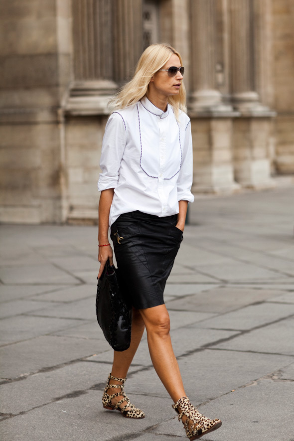 Power dressing simply means a white shirt, black leather and cheetah prints.