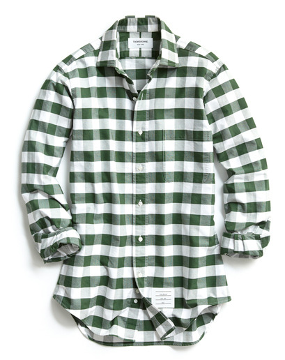 "GQ Selects: Thom Browne Classic Buffalo Check Sportshirt ""This was our favorite of the season. First of all, Thom Browne has never done this exploded gingham. This is his third season experimenting with plaids. What we love about this one is that for the first time he's done a semi-spread collar in an oxford cloth. For that guy who is maybe not a button-down kinda guy but loves the oxford, American-made shirt, this is the next generation. ""—GQ creative director Jim Moore More GQ Selects here."