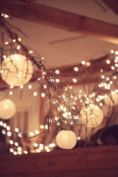asyouwish:  twinkle lights and twigs/branches make nice light swags when accented with paper lanterns.