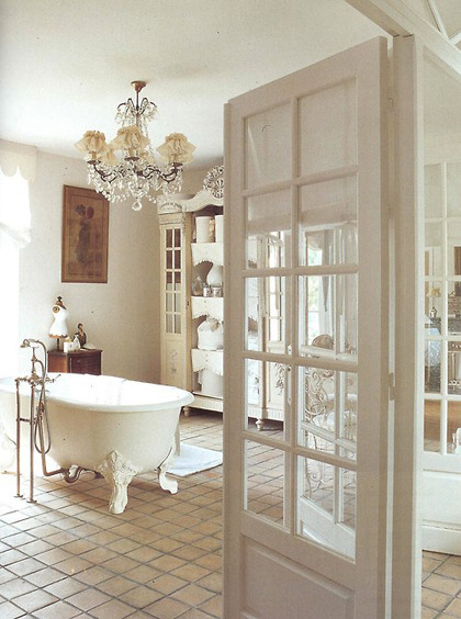 What a bathroom… clawfoot tub, crystal chandelier, French casement doors… swoon (via My Paradissi: Romantic nostalgies)