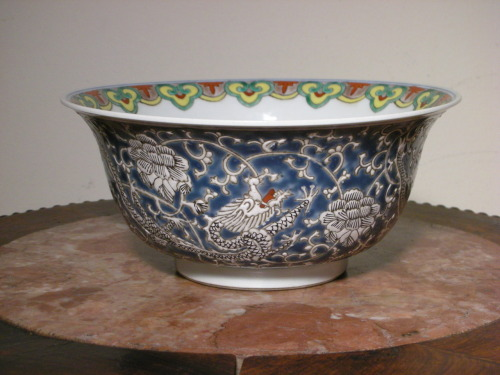 A large Chinese Porcelain Bowl with Three Dragons. Circa: 20th century, China