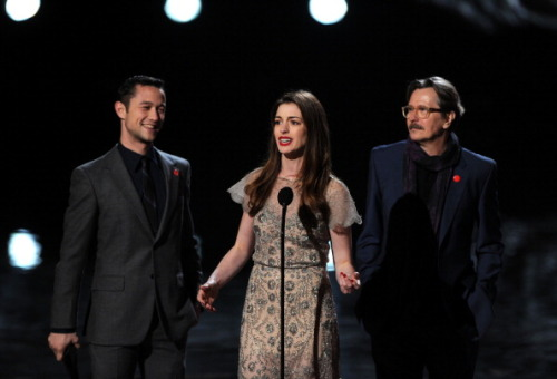 Anne Hathaway does an impression of one of her Dark Knight Rises costars at the Spike Scream Awards.  Which costar?  Well, here's a few hints: it's a major star, who has a history of temper issues and it's Christian Bale.