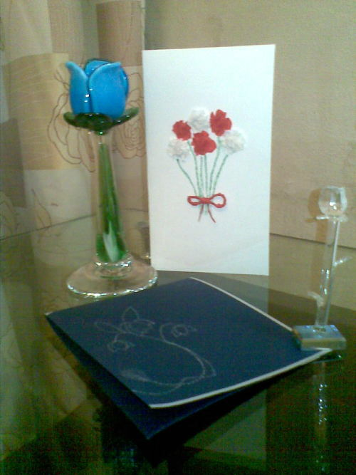WHite: Red and white paper flowers Blue: Silver floral pattern