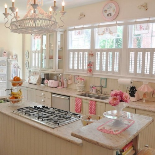 A modern kitchen is loaded with sweet vintage retro-style details (via DigsDigs)