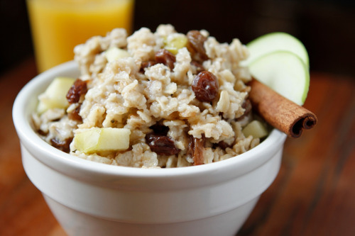Vegan MoFo: Rachel's Amazing Super-Fast Oatmeal I eat the exact same thing for breakfast about 97 percent of the time. Why? Because it's awesome, and also because there's nothing worse in the morning than having to make decisions. Actually, the cat peeing on your bed or a car alarm going off for hours are examples of worse things, but why make life harder, you know? I make a non-instant, microwave version of oatmeal with awesome stuff in it. It's super-healthy, keeps you full, and takes only five minutes, including prep! Disclosure: the photo above is not a photo of my breakfast. It's a photo of someone on Flickr's breakfast because a) they're a way better photographer than me (come on guys, you've seen me try to shoot food) and b) I forgot to take a photo of my breakfast. Ingredients1/3 cup rolled oats (NOT quick-cook or instant. Glue-city!)About 2 Tbsp. chopped date pieces (to taste)Sprinkle of salt2/3 cup waterCinnamonFlax oilSliced almonds (Or even better, those chopped and roasted ones you normally grind into almond butter that they seem to sell nowhere on Earth but the Berkeley Bowl. I'll love you forever and even pay you back if you wanna mail me some of that, SO GOOD.) InstructionsMix the oatmeal, salt, water, and date pieces in a microwave-safe bowl. The date pieces (or other dried fruit) are key: They break the surface tension and help keep your bowl from overflowing (science!). Microwave for 3 minutes. Important: You may have to experiment with your power-level settings here. If your oatmeal overflows and pisses you off, then set the power level lower. I used to have a shitty microwave and it just worked, but now I have a stronger one and have to set it to Power Level 7. Let cool for like a minute, then sprinkle with cinnamon, flax oil, and almonds to taste. I guess you could use other nuts or whatever but I'm almonds all the way, baby. Sometimes when I'm feeling really crazy I sprinkle on some chia seeds, but watch out, those like to nestle between your teeth and make you look dumb when you get to work even though you really did brush them, you swear. Enjoy the deliciousness! Also cinnamon in the A.M. helps you be less hungry all day (Dr. Oz says so)! So do fat and protein! It's really awesome! You're welcome. Now you know what to have in the house for me when I come visit.