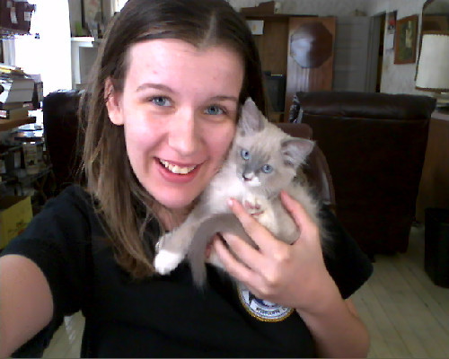 Me and my mom's kitten Esmie, she's a total sweetheart and I love her, even if she does make me really sick. Fuck my allergy to cats.