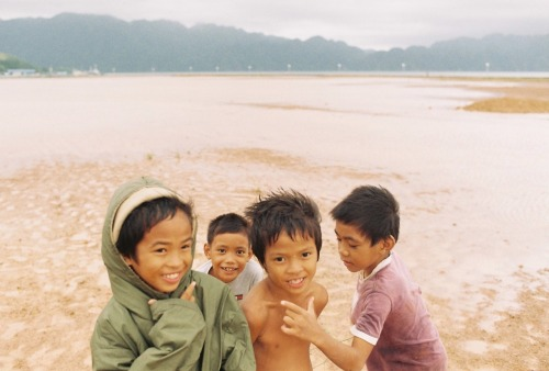 Kids of Coron, at the back is the Majestic Coron Island.