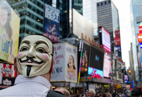 Occupy Wall Street - Mask in Times Sq by Bob Jagendorf on Flickr.