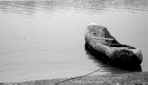 Canoe on Ginak Island Another photograph from The Gambia - I am reminiscing! This was taken shortly after we arrived on Ginak Island. What a serenely beautiful place it was. No gimmicks, no tourists (well, apart from us!), just mangroves, friendly, chilled out people and an abundance of cannabis plants! Ginak is renowned locally for its vast crop of marijuana. Interestingly, the island is said to be haunted by evil spirits and so the police refuse to cross the river to make arrests & seize the crops! Genius!