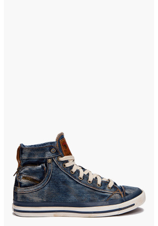 Expoiak Sneakers by DieselHigh top denim sneakers in dusty blue. Cap toe. Off White lace up closure. Silver tone eyelets. Brown leather logo patch at tongue. Eyelets at inner side. Scoop pocket. Zip pocket. Gold tone metal logo flag and gold tone logo rivets at heel. Brown leather pull tab at heel collar. Contrast stitching in beige. Stained White and blue rubber midsole with logo patch at heel. Rubber sole.More…