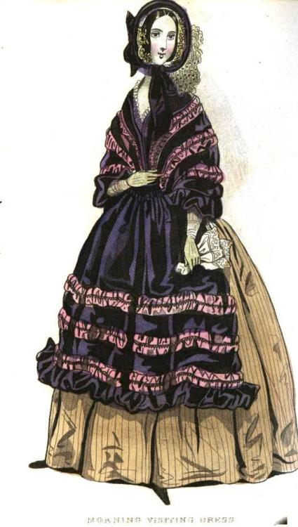 Cabinet des Modes, December 1841.  This is a pretty unusual outfit!  The color combination is expected, but mostly I don't understand what is going on with that cloak/shawl/apron thingy.  It looks like it has a waist on it.  Any of my readers know what is going on here?