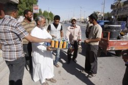 Abbas Fadel, 55, distributes juice to celebrate U.S. Army's withdrawal. #Baghdad, #Iraq 22-10-2011 (AP)