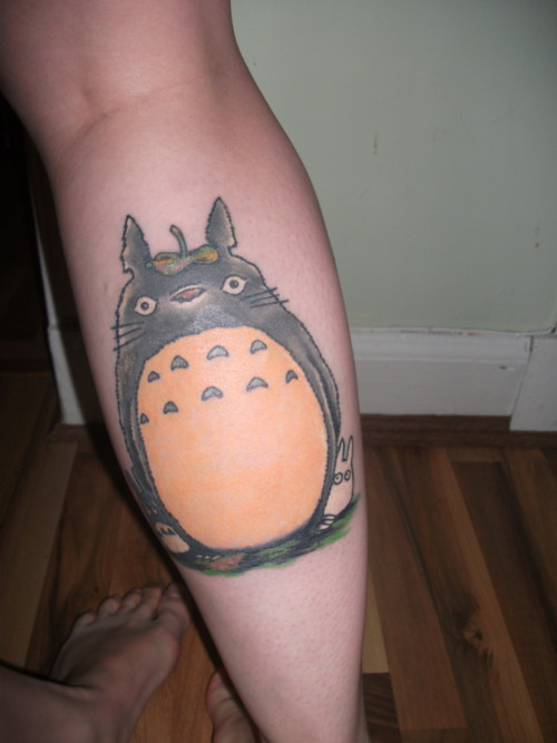 This is my Totoro tattoo, my first big one. And not my last. Every time i watch the movie i feel like a kid again. I was allergic to the green ink so need to get it touched up, but im gona wait to get it fixed so i can get the cat bus from the same movie on my other leg. Every time i see it i smile. Done by Kyle at Forevermore tattoos Glasgow.