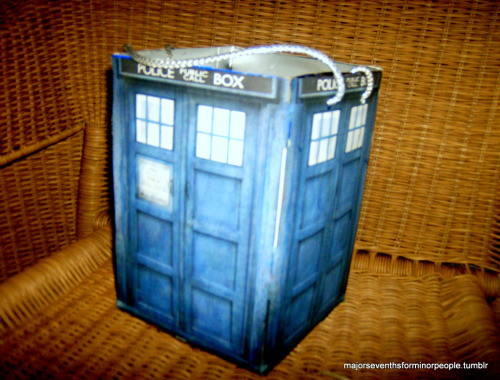 take one oversized goldfish carton, print out some pictures of the tardis, glue that mess together, badda-bing. tardis candy box for halloween.
