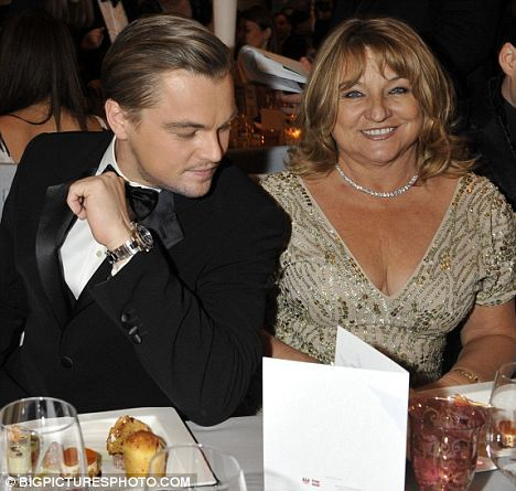 Leonardo DiCaprio staring at those very large breasts i mean boobs i mean tits i mean cups of breast milk