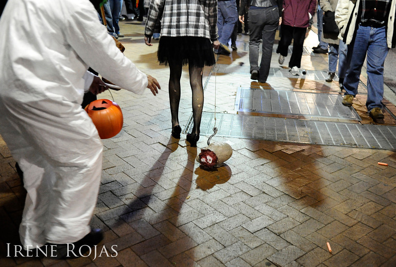 A white-suited zombie chases a head during the Silver Spring Zombie Walk