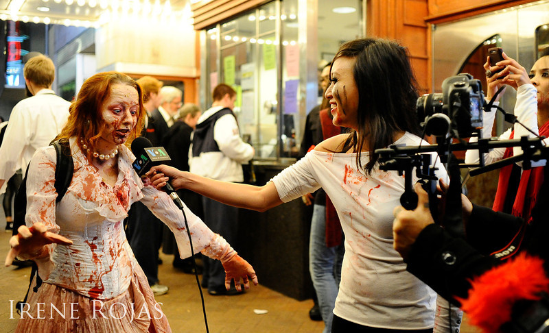 Correspondents from Voice of America interview a zombie in front of the AFI Silver Theatre after the Silver Spring Zombie Walk