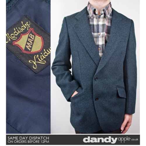 "Newly listed @ www.dandyapple.co.uk Link: http://bit.ly/qXgmtT Mens Vintage Retro Blue-Grey w/Subtle Green Chevron Pattern Wool Blazer. *   Blue grey in colour, with a subtle chevron pattern in the material. *   One inside chest pocket. Two outer hip pockets. *   Low V-neck line. Two button fastening chest. *   Label reads; ""Modische - Kleidung - MAB"". Size: M 38-40"" Chest Material: Wool Mix Condition: No visible faults, marks or stains. Overall, great used vintage condition."