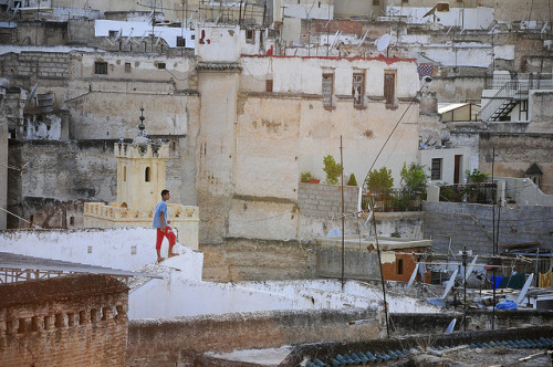 kilele:  Young boy on the roof in Fez, Morocco Photo by Dan Bernard 131 Design