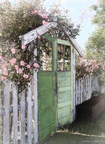 Garden gate made of two old doors, set into a white picket fence… quintessential cottage style romance (via Homage to Wallace Nutting … The Old Garden Gate - a photo on Flickriver)
