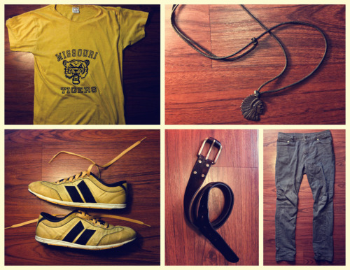WHAT I'M WEARING #001 TEE: 1970s Missouri Tigers Tee - Neck cut deeper for more comfort and less choking NECKLACE: Leather chord with charm- Replaced existing pendant with vintage Indian head charm. SHOES: Macbeth Brighton Ochre/Black - Black laces replaced with yellow. Black eyelets scraped down to silver. BELT: Classic Black Wilson Leather belt. JEANS: Levis 510 Super Skinny Grey.