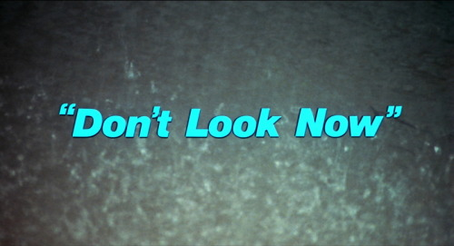 "Halloween Hype 2011, Pt. X  Don't Look Now [1973 / Nicolas Roeg / *****] Roger Ebert's essay on the film better describes the brilliance and beauty of this film than I ever could. I will say that the powerful opening and closing scenes, as well as the stunningly edited sex scene, are three of the best film sequences in history. This remains on of my alltime favourite films. Region 1 really needs a blu-ray release for this, one of the most gorgeous films ever made. On to Mr. Ebert:  Nicolas Roeg's 1973 film remains one of the great horror masterpieces, working not with fright, which is easy, but with dread, grief and apprehension. Few films so successfully put us inside the mind of a man who is trying to reason his way free from mounting terror. Roeg and his editor, Graeme Clifford, cut from one unsettling image to another. The movie is fragmented in its visual style, accumulating images that add up to a final bloody moment of truth. … The shiny red raincoat will be a connector all the way through. In  Venice, Baxter will get glimpses of a little figure in red running away  from him or hiding from him, and may wonder if this is the ghost of his  daughter. We will see the red figure more often than he does, glimpsing  it on a distant bridge, or as a boat passes behind two arches. And the  precise tone of red will be a marker through the movie; Roeg's palate is  entirely in dark earth tones, except when he introduces bright red  splashes—with a shawl, a scarf, a poster on a wall, a house front  painted with startling brilliance. The color is a link between death  past and future. … Venice, that haunted city, has never been more melancholy than in ""Don't Look Now."" It is like a vast necropolis, its stones damp and crumbling, its canals alive with rats. The cinematography, by Anthony B. Richmond and an uncredited Roeg, drains it of people. There are a few shots, on busy streets or near the Grand Canal, when we see residents and tourists, but during the two sustained scenes where John and Laura are lost (first together, later separately) there is no one else about, and the streets, bridges, canals, dead ends and wrong turns fold in upon themselves. Walking in Venice, especially on a foggy winter light, is like walking in a dream. … It is a masterpiece of physical filmmaking, in the way the photography  evokes mood and the editing underlines it with uncertainty."