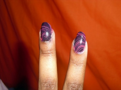 Water-marbling attempt: 1 I'm too tired tonight but tomorrow this mess will be off my nails and It's Delicate by Essie will take its place.