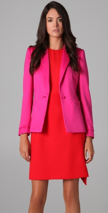 katieermilio:  How would you wear this brilliant pink blazer?  Oh, is it a challenge? Because I can't resist. Winter: black skinny corduroys, white t-shirt, light heather gray sweater, black thigh high boots and a dark gray snood. Summer: white piqué short shorts, sheer white blouse with a white longline bra (visible underneath) and leather wedge sandals.