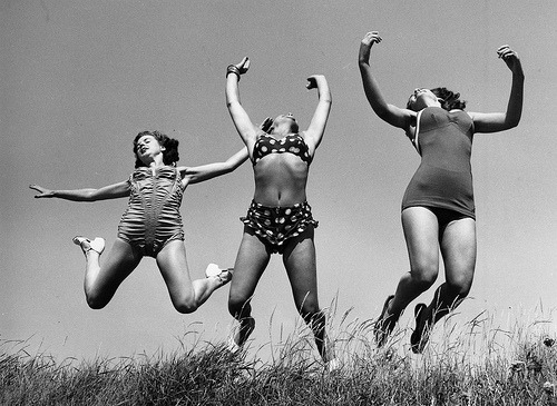 Summer fun Three Windmill Theatre dancers enjoying the sun on the beach at Angmering during a break in rehearsals, 1952 by William Vanderson