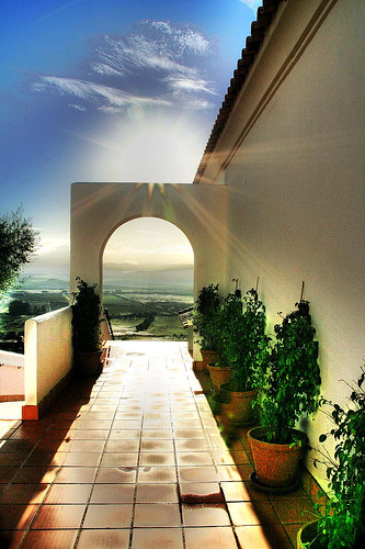 The sun breaks over Cadiz, Andalusia, Spain (by Quearte)