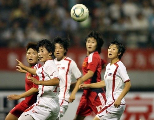 China's and North Korea's players chase down the ball during their Asian women's football qualifier match for the 2012 London Olympic Games in Jinan, in eastern China's Shandong province on September 3, 2011. China and North Korea drew 0-0. (via Photo from Getty Images)