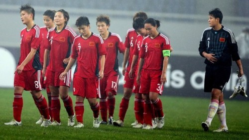 China's players walk off the field after losing to Japan during their Asian women's football qualifier for the 2012 London Olympic Games in Jinan, eastern China's Shandong province on September 11, 2011. Japan beat China 1-0. (via Photo from Getty Images)