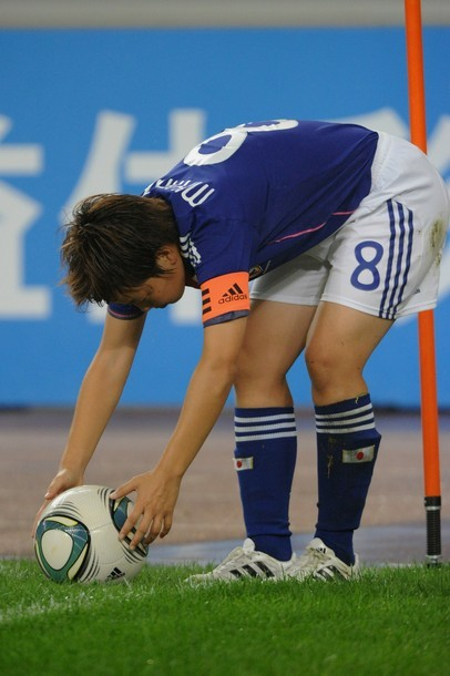 Aya Miyama #8 of Japan sets the ball during the London Olympic Women's Football Asian Qualifier match between Japan and China at Jinan Olympic Sports Centre on September 11, 2011 in Jinan, China. (via Photo from Getty Images)