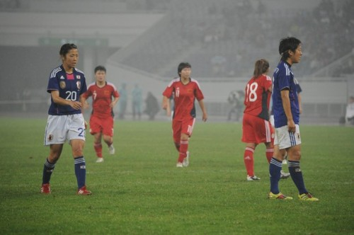 Yuki Nagasato #17 (R) and Asano Nagasato #20 (L), sisters, during the London Olympic Women's Football Asian Qualifier match between Japan and China at Jinan Olympic Sports Centre on September 11, 2011 in Jinan, China. (via Photo from Getty Images)