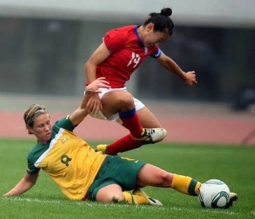 South Korea's Cho So-Hyun (R) avoids a tackle by Australia's Elise Kelon-knight during their Asian women's football qualifier for the 2012 London Olympic Games (via Photo from Getty Images)