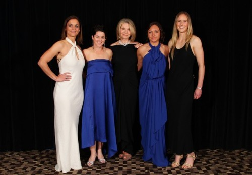 : Fashion designer Carla Zampatti (C) poses with Australian women footballers wearing her designs (L-R) Melissa Barbieri, Sarah Walsh, Kyah Simon and Ellyse Perry during the Australian Football Awards at the Sheraton on the Park on October 4, 2011 in Sydney, Australia. (via Photo from Getty Images)