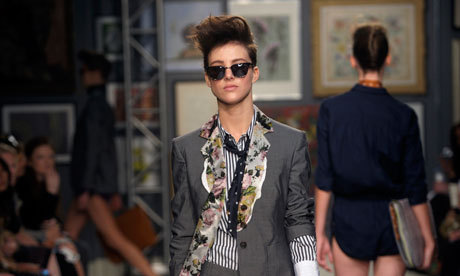 Shape shifter: a Paul Smith suit sharpens up the catwalk. I'm a huge fan of the androgynous look. The key point is the fit. The  shirts and jackets should fit neatly on the shoulders and must not be  too long. Trousers should be slim and elegant. Go for neat styles that  flatter, rather than hide, your feminine proportions. It's nice to add  some feminine touches, such as delicate jewellery. If you are wearing a  shirt, unbutton it partly so it shows some skin or a pretty top  underneath. PAUL SMITH, DESIGNER