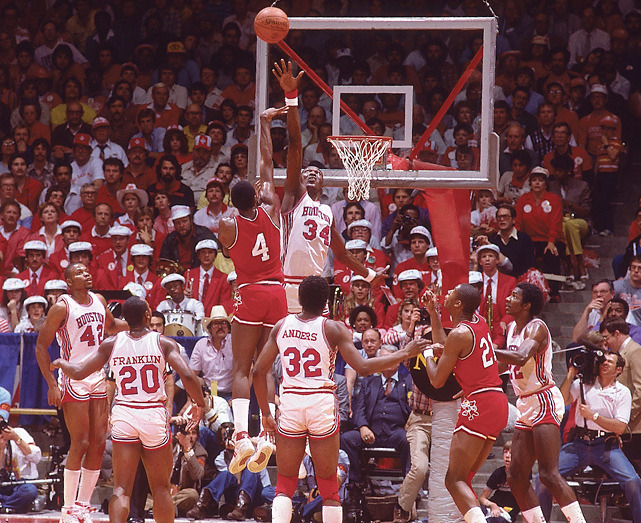 Houston's Akeem Olajuwon contests a shot against Louisville during the semifinal round of the 1983 Final Four. (Manny Millan/SI) SI VAULT: Houston's Phi Slamma Jamma fraternity is piling up wins (3.7.83)SI VAULT: For Houston, Akeem was a dream (4.4.83)