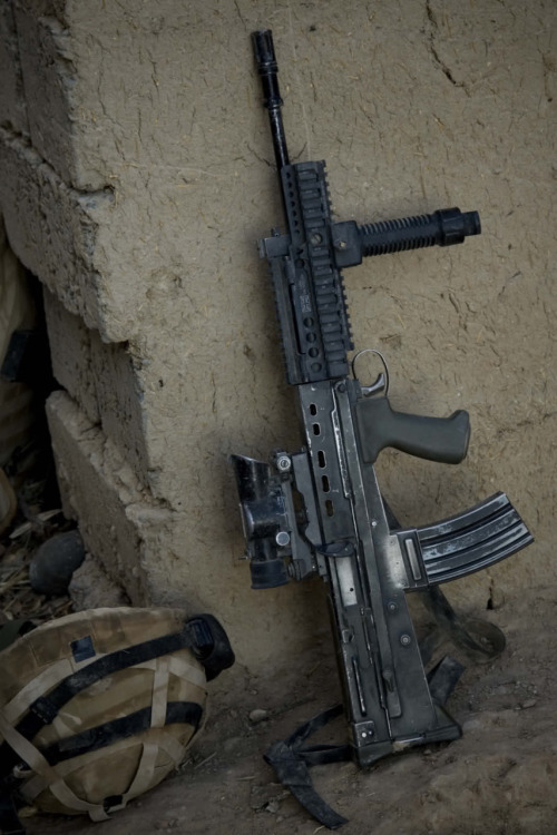 The L85A2 is a selective firing, gas-operating, 5.56×45mm spitting badass motherfucker.