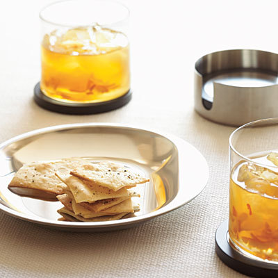 Marmalade Sour Ingredients 6 tablespoons orange marmalade   1 cup plus 2 tbsp. bourbon or rye whiskey  3 tablespoons lemon juice  Ice  Preparation In a pitcher or 2-pint measuring cup, dissolve orange marmalade in 3/4 cup hot water. Stir in bourbon and lemon juice. Fill six 8- to 12-oz. glasses with ice and pour 1/3 to 1/2 cup cocktail mixture into each glass, making sure each serving gets some of the orange peel that settles at the bottom of the mixture. Serve marmalade sours immediately.