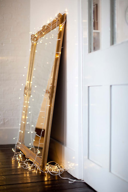 vintage mirror and fairy lights (via sneak peek: emma jane noren | Design*Sponge)