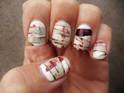 10minicanvases:  just some Halloween nail art, it's pretty under wraps *dah-doo tst!* greenish layer - American Apparel California Trooper with a mix of OPI Jade is the New Black and American Apparel Office dabbed on topwhite - American Apparel Cottongrey - China Glaze Concrete Catwalkscary red blood smears - China Glaze Brownstoneblack - American Apparel Hassidred eyes - China Glaze Salsa and China Glaze Ruby Pumpsa coat of Seche Vite Dry Fast Top Coat!  as usual