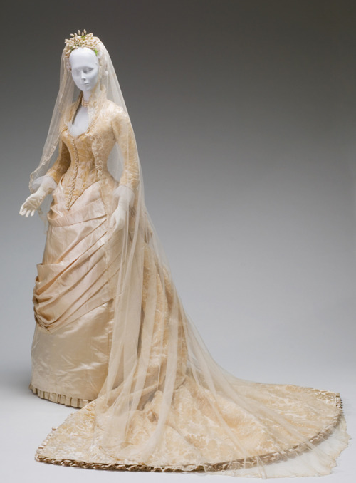 Wedding Dressby L.P. Hollander & Co. 1884 Mint Museum - Charlotte NCHistoric Costume and Fashionable Dress Collection   Our museum here only has a few costumes but some of them are stunning.  I've got some blurry and unrecognizable awesome pictures I took of this dress at the exhibit that's going on right now.